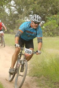 Photo of agent, Rich Bosslemann, riding a bike during a race